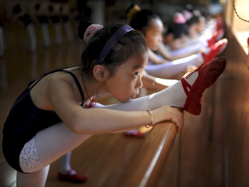 Children practise ballet at an activity center in Hefei, Anhui province. Reuters photo