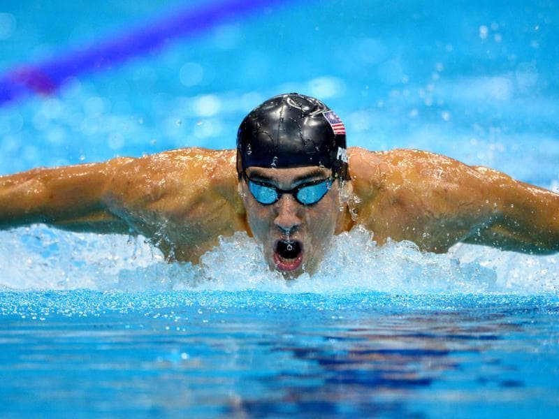 US swimmer Michael Phelps competes in the men's 200m butterfly final during the swimming event at the London 2012 Olympic Games in London. AFP photo/Fabrice Coffrini