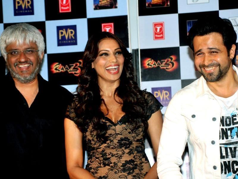 Director Vikram Bhatt, Emraan Hashmi and Bipasha Basu share a good laugh during the launch. (AFP Photo)