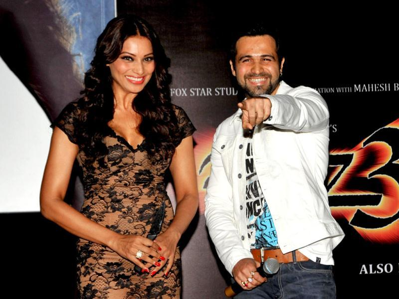 All Smiles: Bipasha Basu and Emraan Hashmi look more than cheerful at the event. (AFP Photo)