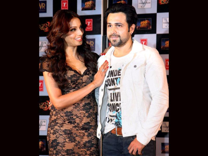 Posers: Actors Bipasha Basu and Emraan Hashmi join the league of on-screen couples who don't fit together, visually. The duo pose during the launch of the first trailer of upcoming horror film Raaz 3 directed by Vikram Bhatt in Mumbai on July 30. (AFP Photo)
