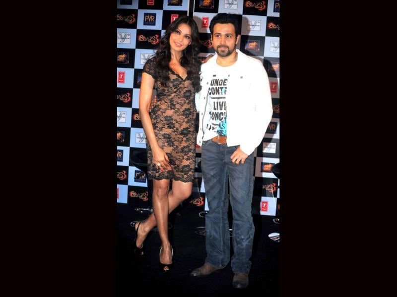 Bipasha Basu smiles at her co-star Emraan Hashmi as they promote the first trailer of Raaz 3. (PTI Photo)