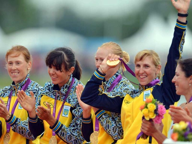 Ukraine's team celebrates on the podium after receiving their gold medals won in the women's quadruple sculls final A of the rowing event during the London 2012 Olympic Games, at Eton Dorney Rowing Centre in Eton, west of London. AFP Photo/Eric Feferberg