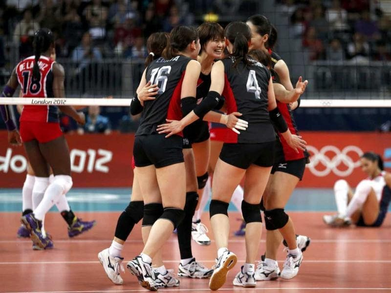 Japan's players celebrate a point against the Dominican Republic during their women's Group A volleyball match at Earls Court during the London 2012 Olympic Games. Reuters/Ivan Alvarado