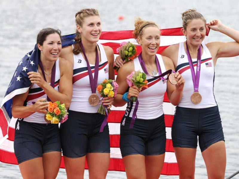 US rowers Adrienne Martelli, Megan Kalmoe, Kara Kohler, and Natalie Dell display the bronze medals they won in the women's rowing quadruple sculls in Eton Dorney, near Windsor, England, at the 2012 Summer Olympics. AP Photo/Armando Franca