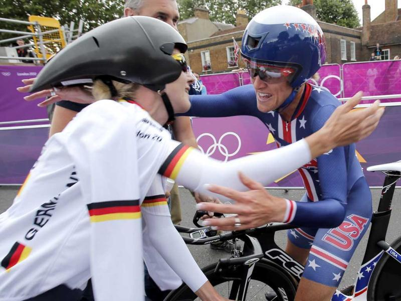 Kristin Armstrong of the United States, hugs Silver Medalist Judith Arndt, of Germany, after clinching the gold medal in the women's individual time trial cycling event at the 2012 Summer Olympics in London. AP Photo/Christophe Ena