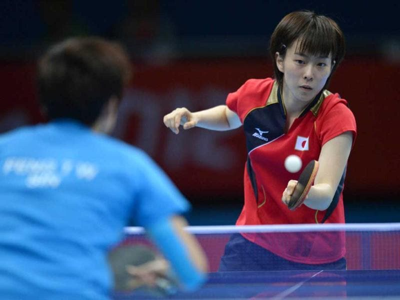 Japan's Kasumi Ishikawa plays a return during her table tennis women's bronze medal singles match against Singapore's Feng Tianwei for The London 2012 Olympic Games at The Excel Centre in London. AFP Photo/Saeed Khan