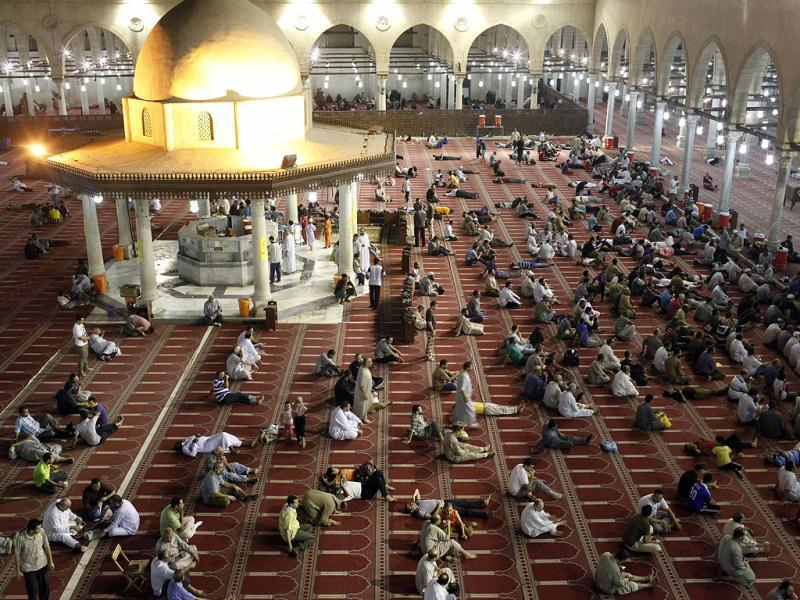 Men rest before performing evening prayers in the holy month of Ramadan at a mosque in Cairo. Reuters photo/Asmaa Waguih