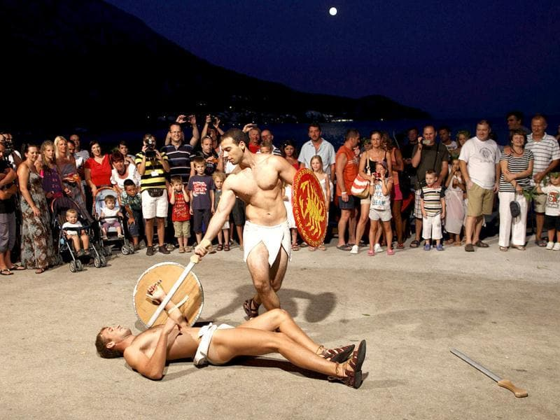 Performers re-enact a sword fight during the Night of King Arthur in Igrane. Historian John Matthews believes the gravestone found in Dalmatia near Podstrana, about 70 km (43 miles) from Igrane is really King Arthur's. Reuters photo/Antonio Bronic