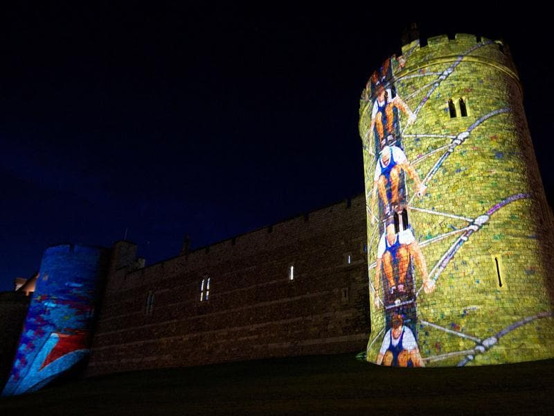 Windsor Castle is lit up with pictures of British Olympic rowers, past and present to coincide with the London 2012 Olympic Games rowing events held in the area, in Windsor. AFP Photo/Andrew Cowie
