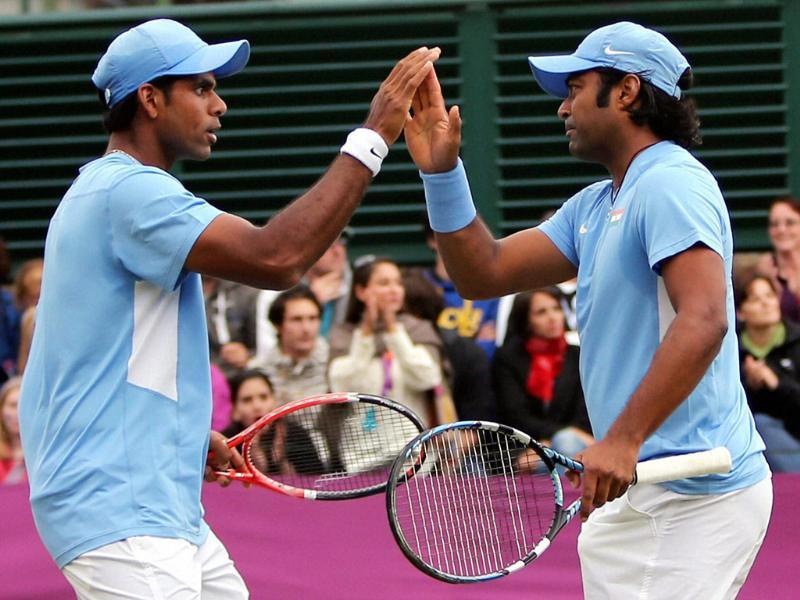 India's Leander Paes and V Vardhan celebrate a point during doubles match against France's M Llodra and JW Tsonga at Wimbledon, London during the 2012 Summer Olympics. (PTI Photo by Manvender Vashist)