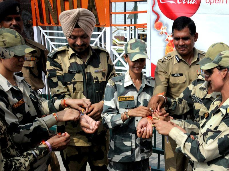 BSF women constables tying rakhis on the wrists of BSF officers on the occasion of Raksha Bandhan festival at Indo Pak Attari/Wahga International Border, about 35 km from Amritsar. PTI photo/Deepak Sharma