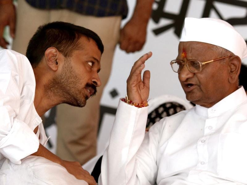 Social activist Anna Hazare speaks to Arvind Kejriwal, a member of his team during their hunger strike in New Delhi. (Reuters)
