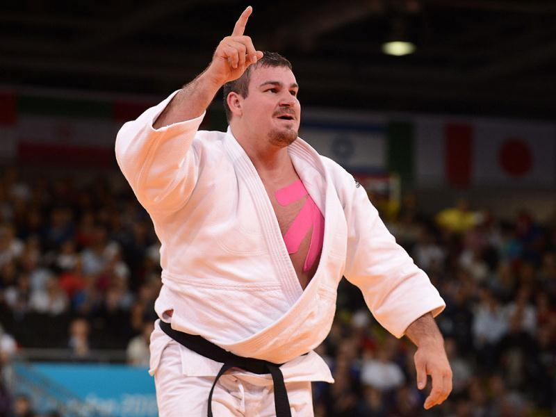 Germany's Andreas Toelzer celebrates after winning his men's +100kg judo contest first round match of the London 2012 Olympic Games at the Excel arena in London. AFP Photo/Toshifumi Kitamura