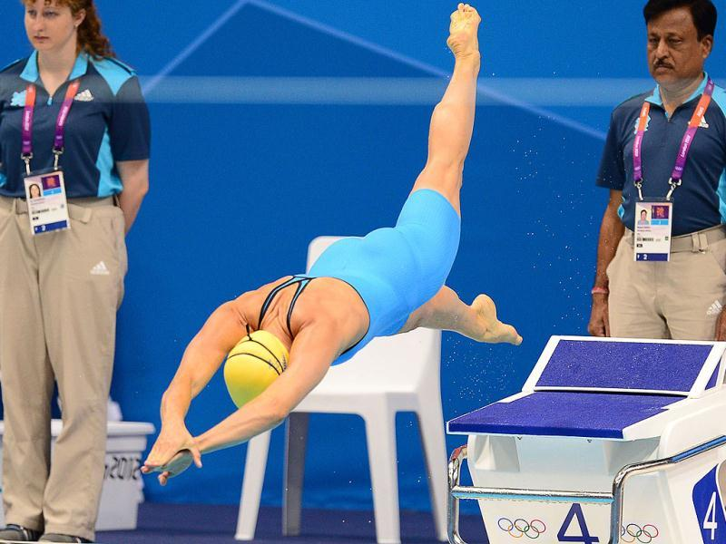 Sweden's Therese Alshammar dives as she competes in the women's 50m freestyle heats during the swimming event at the London 2012 Olympic Games in London. AFP Photo/Martin Bureau
