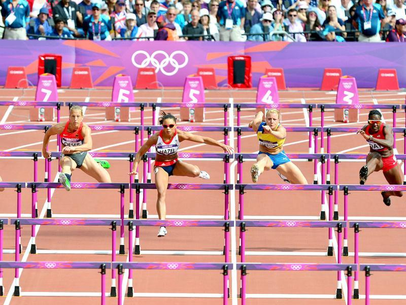 (From L) Latvia's Laura Ikauniece, Germany's Jennifer Oeser, Britain's Louise Hazel, Sweden's Jessica Samuelsson and US' Sharon Day compete in the women's heptathlon 100m hurdles heats at the athletics event during the London 2012 Olympics in London. AFP Photo/Gabriel Bouys
