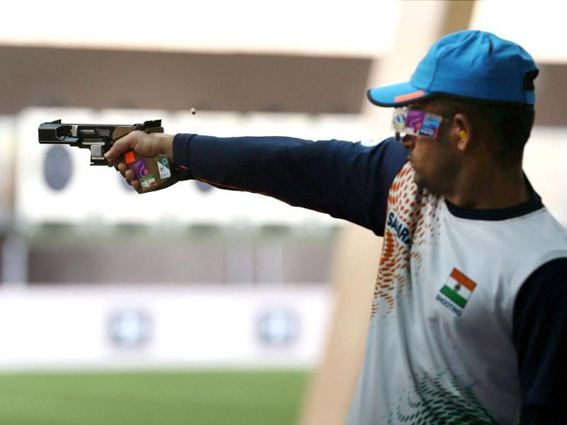 India's Vijay Kumar during the men's Rapid fire Pistol Qualification round at Royal Artillery Barracks during Olympic Games 2012 in London. (AP Photo)
