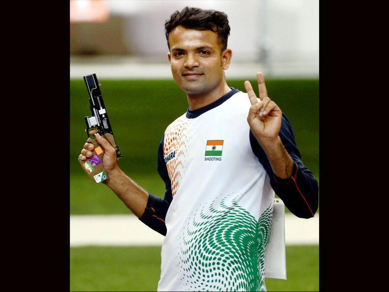 Vijay Kumar celebrates after winning silver medal in the men's 25m rapid fire pistol shooting event at the 2012 Olympic Games in London. AP photo