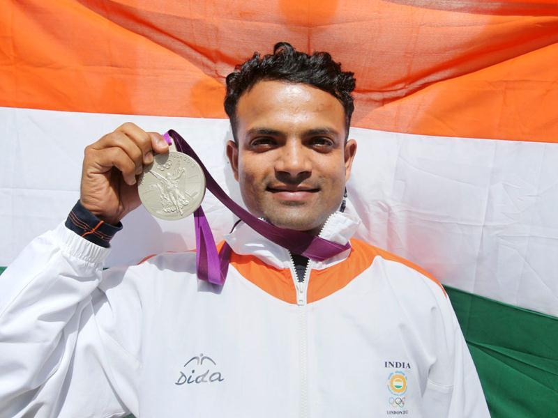 India's Vijay Kumar celebrates after winning silver medal in the men's 25m rapid fire pistol shooting event at the 2012 Olympic Games in London . PTI Photo by Manvender Vashist
