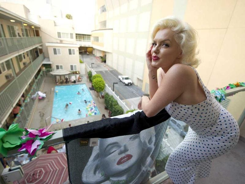 British actor and Marilyn Monroe lookalike Suzie Kennedy attends the Immortal Marilyn Pool Party at the Hollywood Orchid Suites hotel in Hollywood, California.AFP Photo/ Robyn Beck
