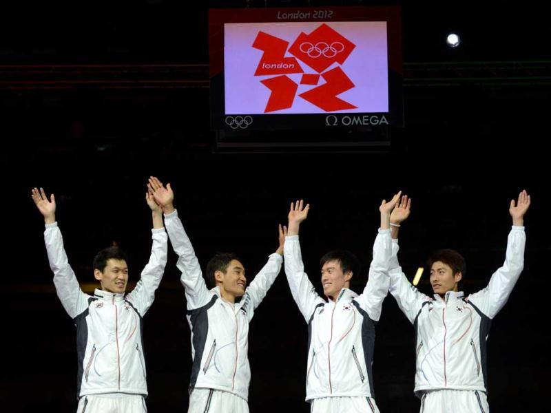 South Korea's team celebrate winning gold on the podium of the men's sabre team as part of the fencing event of London 2012 Olympic games, at the ExCel centre in London. AFP Photo/Toshifumi Kitamura