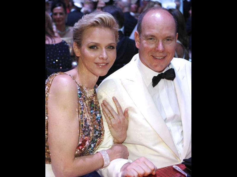 Prince Albert II of Monaco and princess Charlene attend the 64th annual Red Cross Gala, in Monaco. Created in 1948, the gala is an annual charity event held in Monaco by its Princely Family during the summer. AFP Photo/Pool/ Lionel Cironneau
