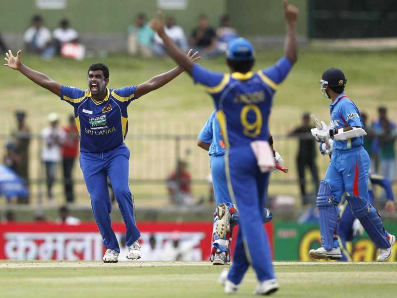 Sri Lanka's Thisara Perera (L) celebrates taking the wicket of Ajinkya Rahane during their final one-day international cricket match in Pallekele. Reuters
