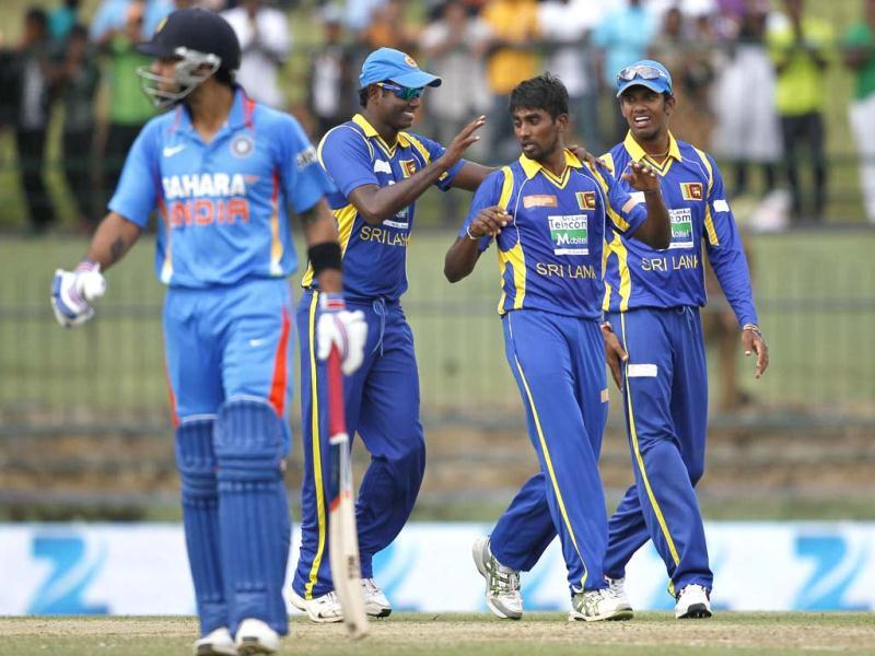 Sri Lanka's bowler Nuwan Pradeep, second right, celebrates the dismissal of Virat Kohli, left, with Sachithra Senanayake, right and Angelo Mathews during their fifth one day international cricket match in Pallekele. AP Photo/Gemunu Amarasinghe
