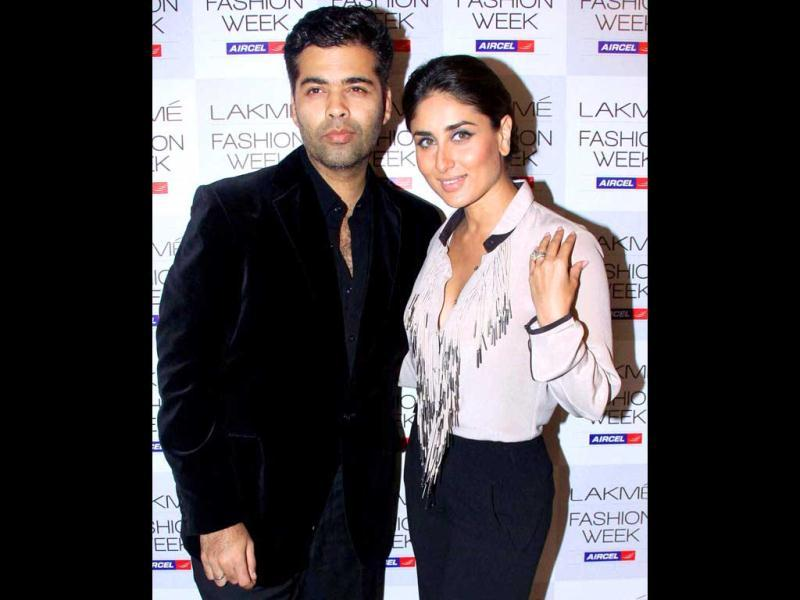 Kareena Kapoor is experimenting with her style a lot of late! The actress at her stylish best poses with director Karan Johar at the Lakme Fashion Week in Mumbai on August 3. (PTI Photo)