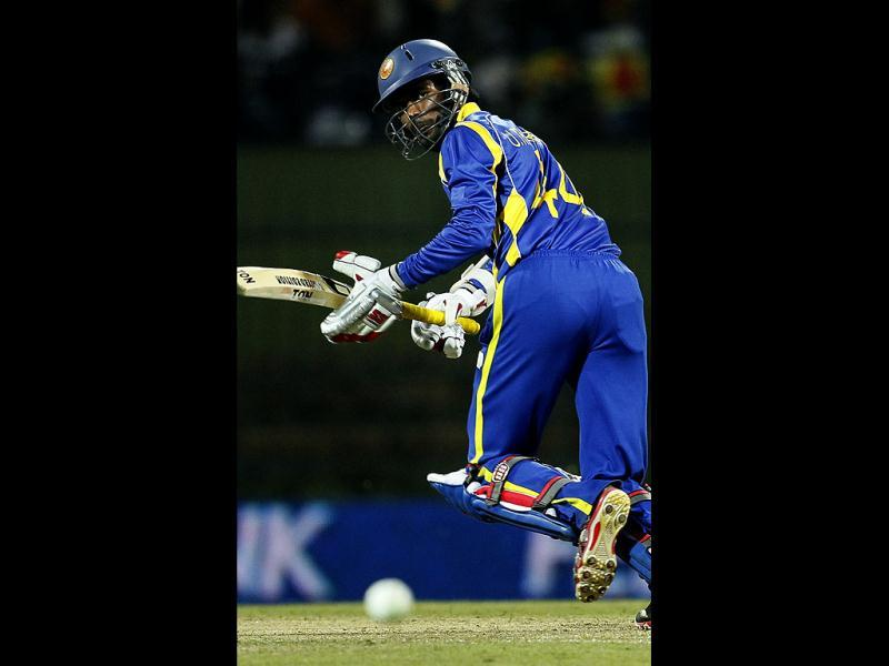 Sri Lanak's batsman Upul Tharanga runs between the wickets during the fifth one day international cricket match between India and Sri Lanka in Pallekele, Sri Lanka. (AP Photo/Gemunu Amarasinghe)