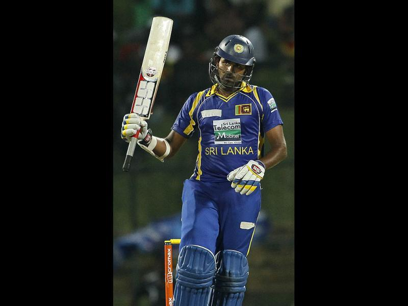 Sri Lanka's batsman Lahiru Thirimanne celebrates after scoring a half century during the fifth one day international cricket match between India and Sri Lanka in Pallekele. (AP Photo/Gemunu Amarasinghe)