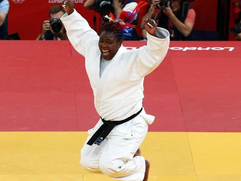 Cuba's Idalys Ortiz celebrates after winning her women's +78kg gold medal judo match against Japan's Mika Sugimoto at the London 2012 Olympic Games. Reuters/Darren Staples