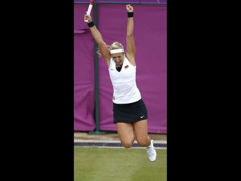 Germany's Sabine Lisicki celebrates after defeating Kazakhstan's Yaroslava Shvedova in their women's singles tennis match at the All England Lawn Tennis Club during the London 2012 Olympic Games. Reuters/Marcelo Del Pozo