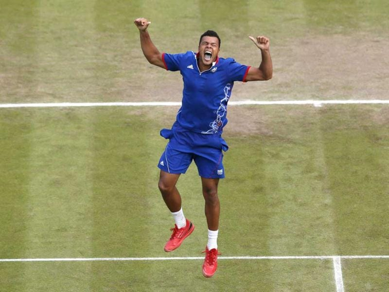 France's Jo-Wilfried Tsonga celebrates after defeating Canada's Milos Raonic in their men's singles tennis match at the All England Lawn Tennis Club during the London 2012 Olympic Games. Reuters/Stefan Wermuth