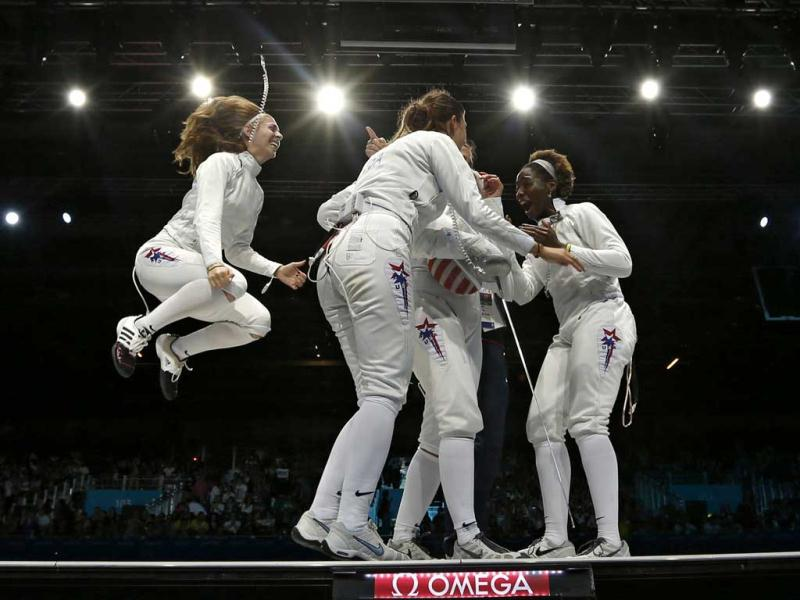 (L-R) Susie Scanlan Kelley Hurley, Courtney Hurley and Maya Lawrence of the US celebrate their victory at the end of the women's eppe team bronze medal fencing competition against Russia at the ExCel venue during the London 2012 Olympic Games. Reuters/Damir Sagolj