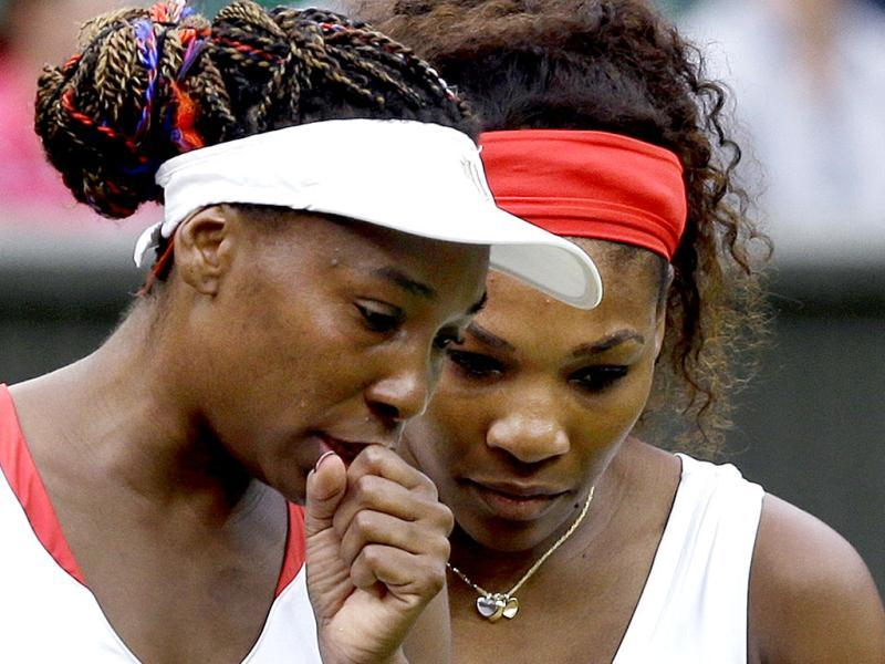 Venus and Serena Williams talk as they compete against Andrea Hlavackova and Lucie Hradecka of the Czech Republic during the gold medal women's doubles match at London Olympics. AP Photo/Elise Amendola