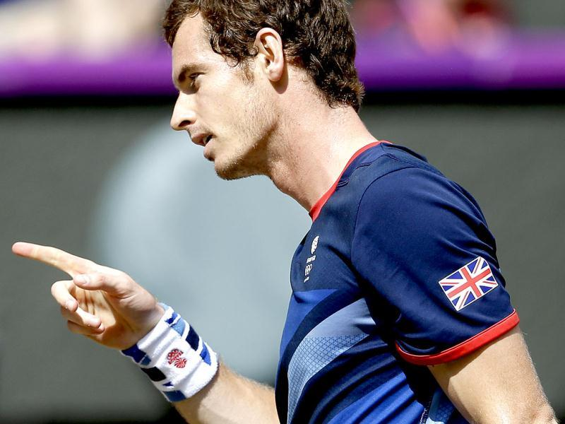 Britain's Andy Murray reacts after winning a point during the men's singles gold medal match against Switzerland's Roger Federer at the All England Lawn Tennis Club at Wimbledon, in London, at the 2012 Summer Olympics. AP Photo/Victor R. Caivano