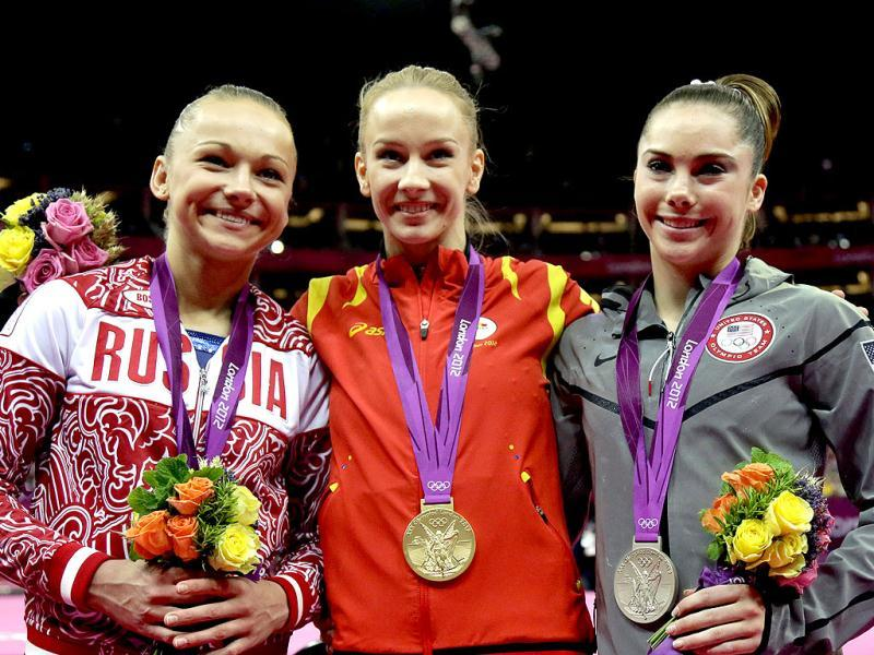 Russian bronze medallist gymnast Maria Paseka, left, Romania's gold medallist gymnast Sandra Raluca Izbasa, center, and US silver medallist gymnast McKayla Maroney stand during the podium ceremony for the artistic gymnastics women's vault finals at the 2012 Summer Olympics in London. AP Photo/Julie Jacobson