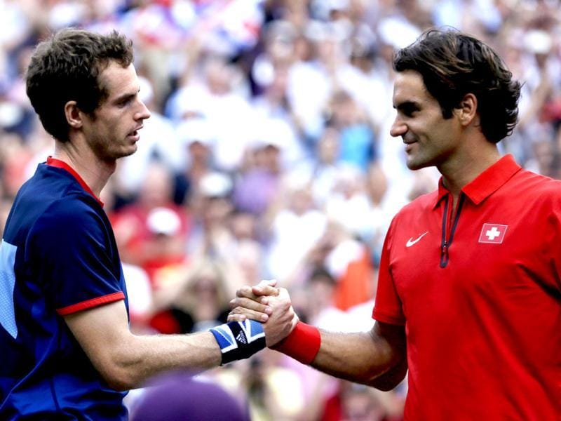 Britain's Andy Murray shakes hands with Switzerland's Roger Federer after the men's singles gold medal match at the All England Lawn Tennis Club at Wimbledon, in London, at the 2012 Summer Olympics. Murray won the gold medal. AP Photo/Victor R. Caivano