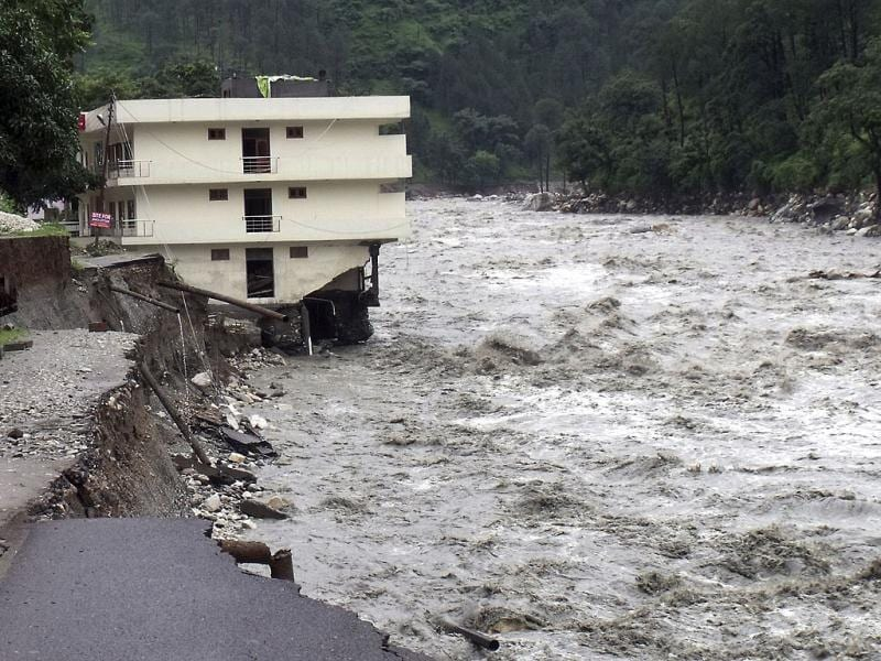 Part of a three storey building is washed away in flash floods in the Uttarkashi district, Uttarakhand. (AP Photo)