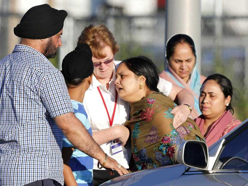A distraught woman is comforted outside the Sikh gurdwara in Oak Creek, Wisconsin. At least 7 were killed in a shooting at a Sikh gurdwara in Wisconsin. Reuters/Tom Lynn