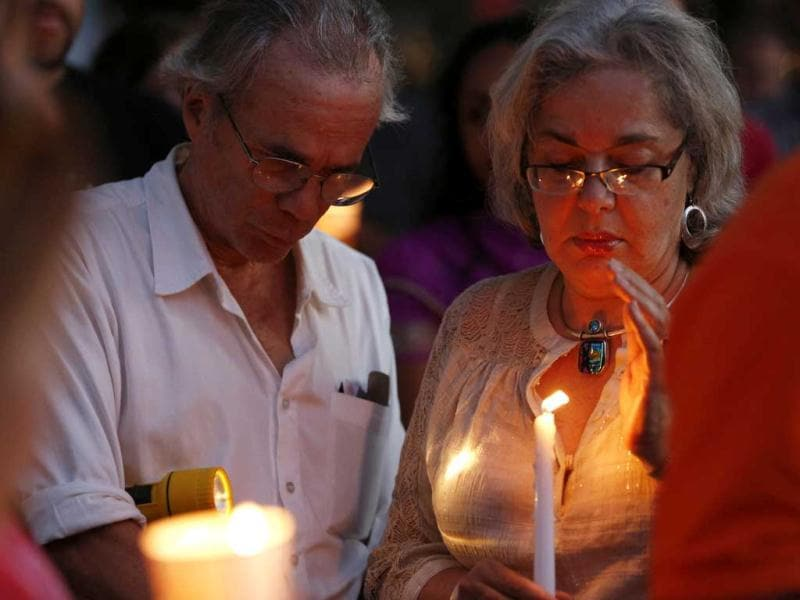 People gather at a candle light vigil at Cathedral Square in downtown Milwaukee, Wisconsin. Reuters/Tom Lynn