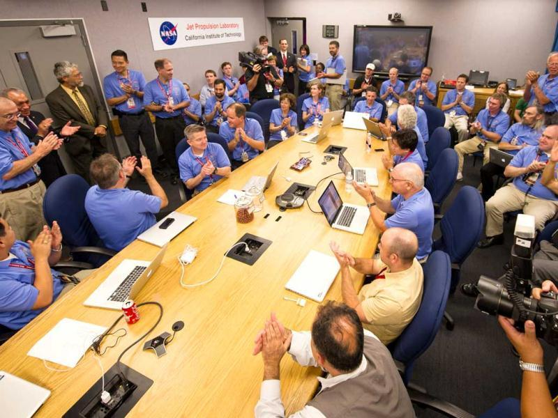 In this photo provided by Nasa, the Mars Science Laboratory (MSL) team welcomes White House Science and Technology Advisor John Holdren, third standing from left, at JPL in Pasadena, California. (AP Photo/NASA, Bill Ingalls)