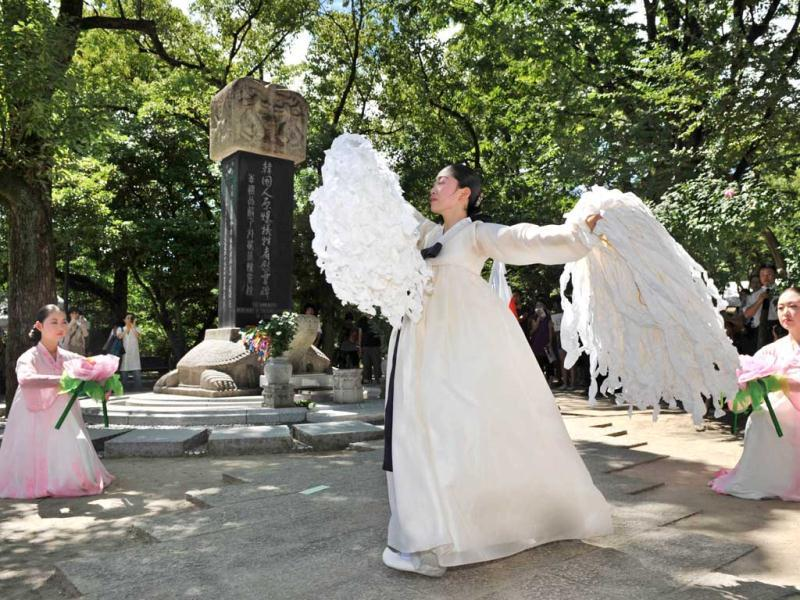 Dancers perform in traditional Korean costume as part of a memorial service for Korean victims of a 1945 atomic bombing, at the Peace Memorial Park in Hiroshima. Tens of thousands of people attend services every year to remember the more than 200,000 people estimated to have died in the bombings. (AFP/ Kazuhiro Nogi)