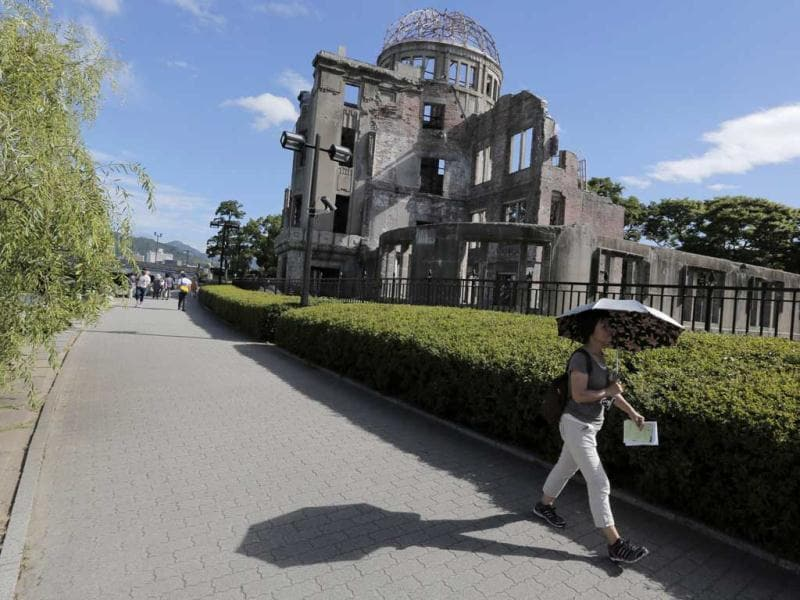 .A woman walks past Atomic Bomb Dome in Hiroshima, western Japan. Hiroshima will mark the 67th anniversary of the atomic bombing. (AP/Itsuo Inouye)