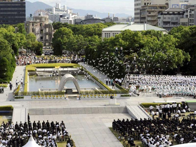 The 67th memorial service for atomic bomb victims is held at the Peace Memorail Park behind the atomic bomb dome in Hiroshima in western Japan on. Tens of thousands of people marked the anniversary of the atomic bombing of Hiroshima, as a rising tide of anti-nuclear sentiment swells in post-Fukushima Japan. (AFP/ Jiji Press)