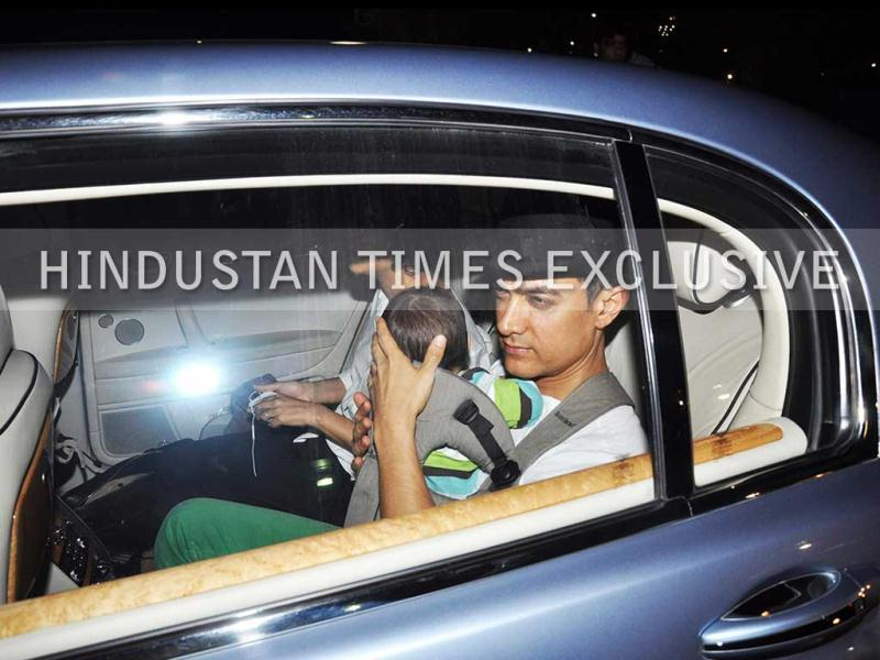 Aamir Khan, his son Azad Rao Khan and wife Kiran Rao were on their way to Chicago where the actor was shooting for Dhoom 3.