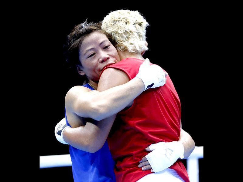 MC Mary Kom embraces Maroua Rahali of Tunisia after defeating her in their quarterfinal Women's Fly (51kg) boxing match at the London Olympic Games. Reuters photo/Murad Sezer