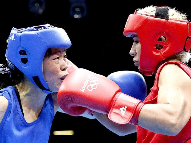 Maroua Rahali of Tunisia defends against MC Mary Kom during the women's flyweight boxing quarterfinals of the 2012 London Olympic Games at the ExCel Arena in London. AFP Photo/Jack Guez