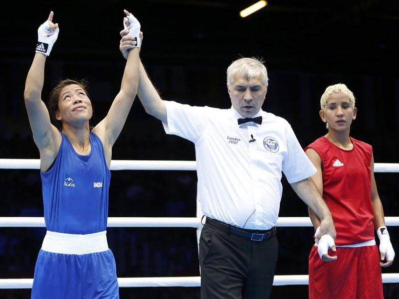MC Mary Kom is declared the winner over Maroua Rahali of Tunisia after their quarterfinal Women's Fly (51kg) boxing match at the London Olympic Games. Reuters photo/Murad Sezer